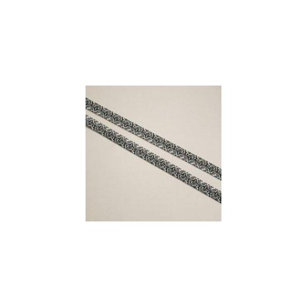 Folde elastik med sort-hvidt mønster