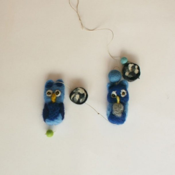 Nålefiltede ugler i guirlande